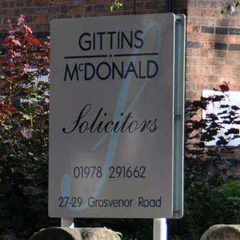Gittins McDonald Solicitors sign on Grosvenor Road in Wrexham town centre